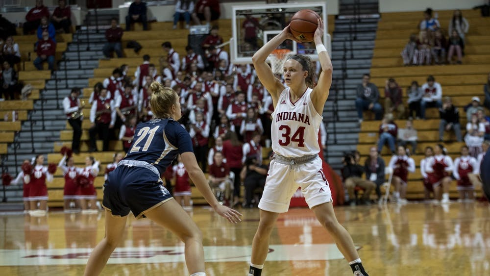 Sophomore Grace Berger looks to pass the ball Nov. 7 at Simon Skjodt Assembly Hall. Berger scored 24 points against Mount St Mary's University.