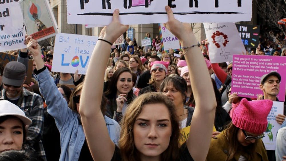 Moira Kehoe, an IU freshman, holds a sign during the Women's March on Jan. 20, 2017, in Indianapolis. There will be an anniversary march focused on voter registration Jan. 20 at the American Legion Mall in Indianapolis.