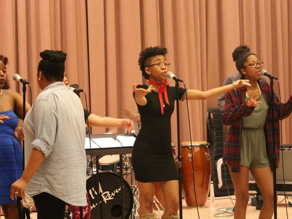 Some of the ladies of the IU Soul Revue rehearse a song from their upcoming spring concert Wednesday evening at the Neal Marshall Black Culture Center. The IU Soul Revue is one third of the African American Arts Institute.