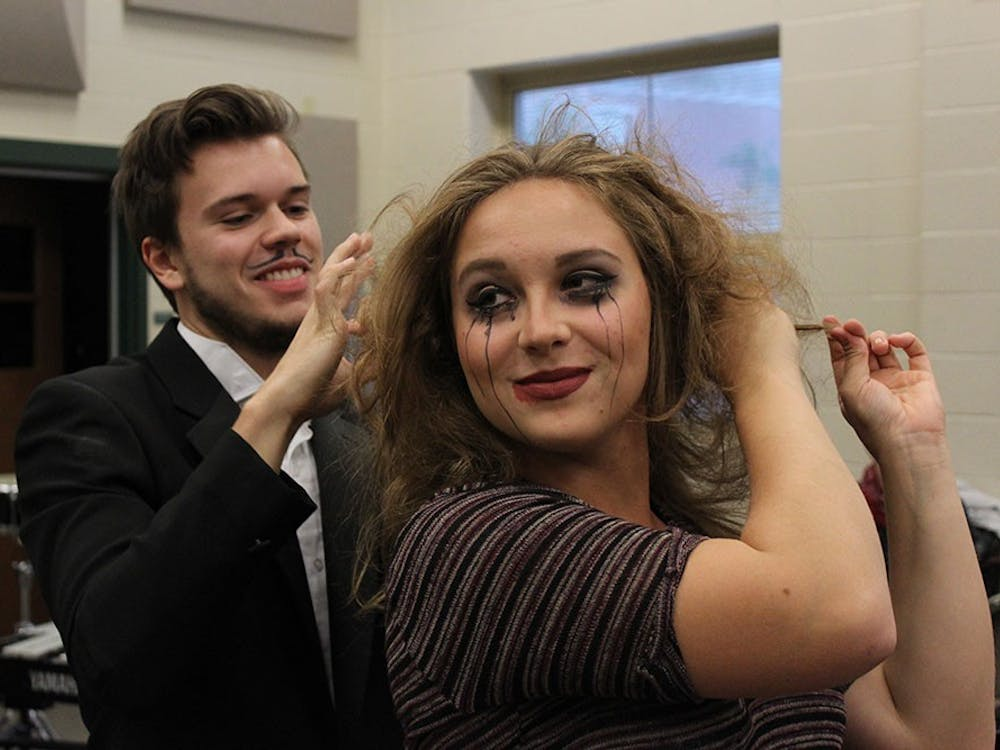 """Ashlyn Brown who plays Mad Margaretin the opera """"Ruddigore"""" teases her hair as she prepares for a dress rehearsal. The University Gilbert & Sullivan Society is performing the opera Friday, Saturday and Sunday."""