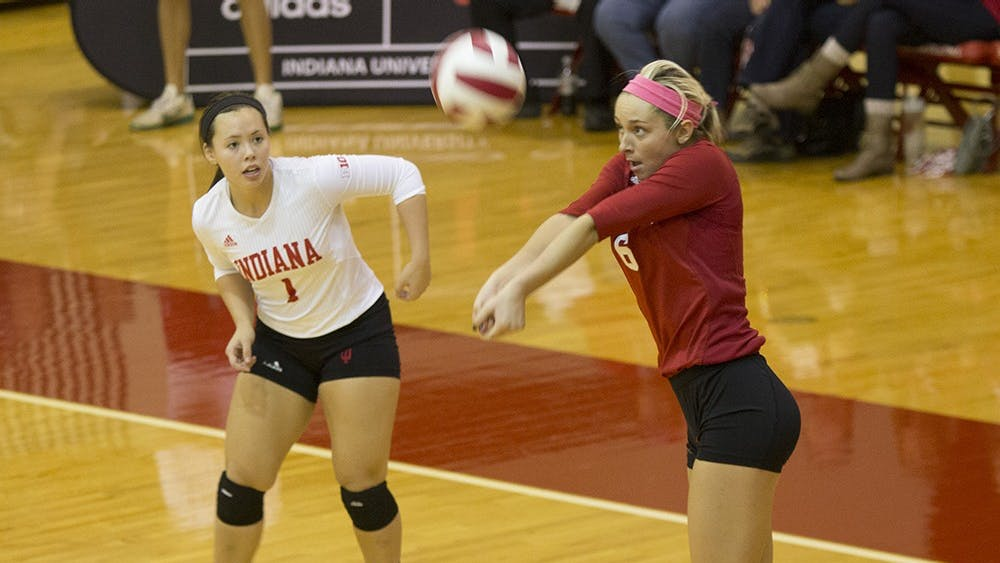 Sophomore Taylor Lebo sets the ball during the Hoosiers' game versus Penn State on Saturday.