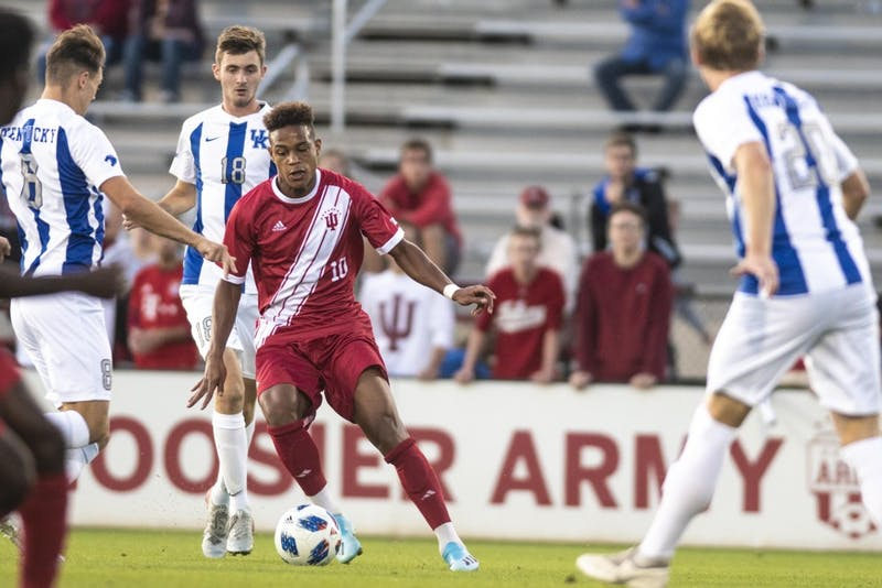 Senior Joris Ahlinvi dribbles through several University of Kentucky defenders Oct. 9 at Bill Armstrong Stadium. The match finished in a 0-0 draw.