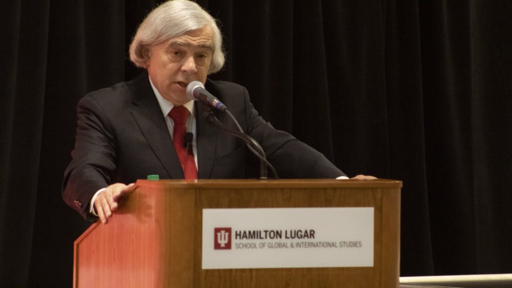 """Ernest J. Moniz, former United States Secretary of Energy and CEO of Nuclear Threat Initiative, speaks about the nuclear arms race March 22 during the """"America's Role in the World"""" conference. Moniz said there is no political space for anyone who wants to carry on a constructive dialogue with Russia right now."""