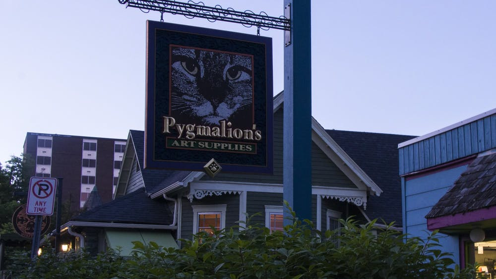 The sign for Pygmalion's Art Supplies is pictured at dusk May 31 on North Grant Street. The shop is closing permanently on June 30.