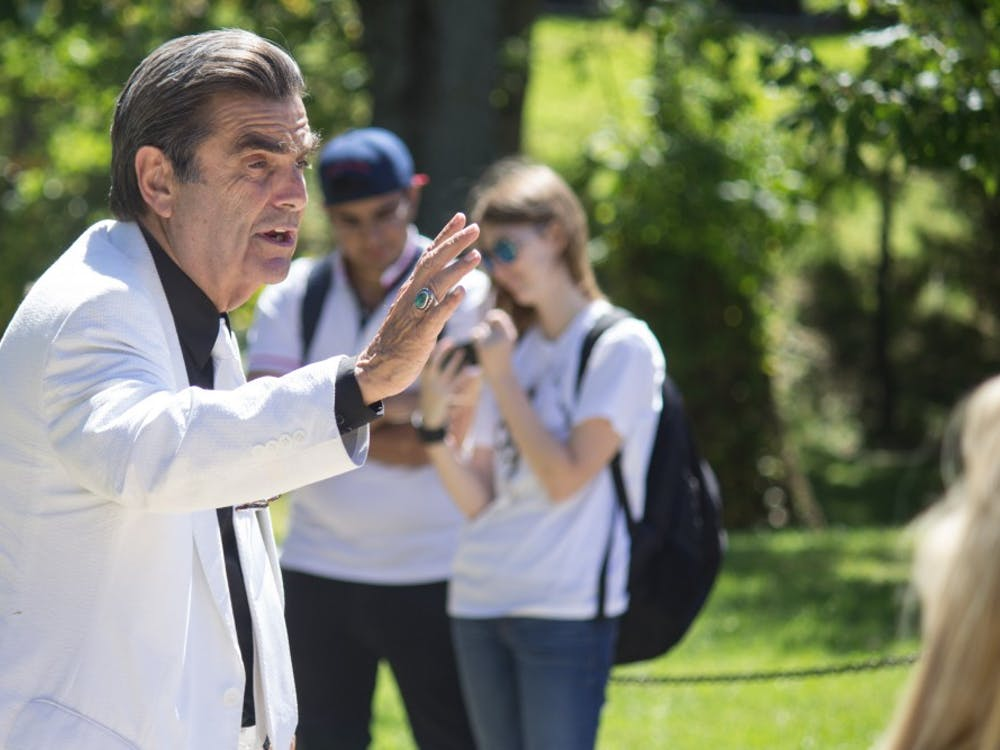 Brother Jed speaks to students about his spiritual journey Aug. 24, 2015, at the clock tower behind Woodburn Hall. Students in the crowd shouted questions back and took photos while he preached.