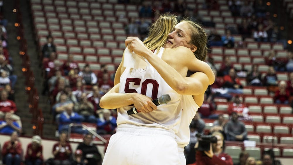 Junior Ali Patberg embraces senior Brenna Wise after giving a speech Feb. 27 in Simon Skjodt Assembly Hall. No. 22 IU beat Nebraska 81-53, Wise was honored as the only senior on the team.