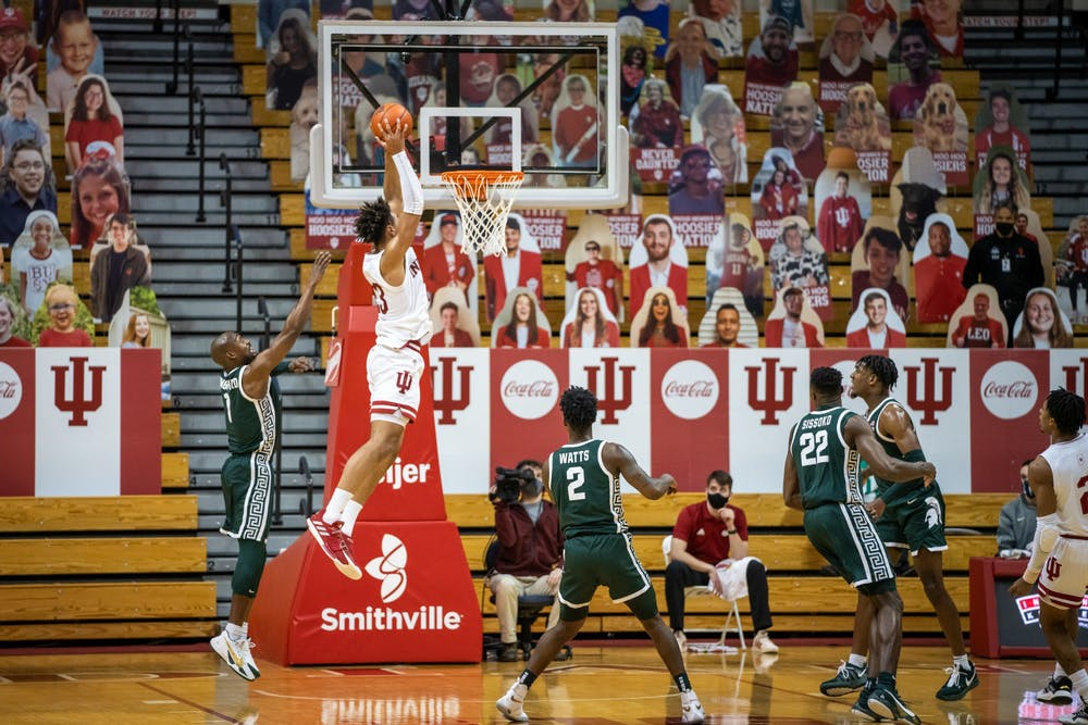 <p>Sophomore forward Trayce Jackson-Davis catches an alley-oop pass before dunking it down Saturday at Simon Skjodt Assembly Hall. Jackson-Davis finished the game with 34 points and nine rebounds.</p>