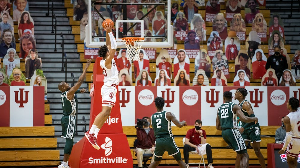 Sophomore forward Trayce Jackson-Davis catches an alley-oop pass before dunking it down Saturday at Simon Skjodt Assembly Hall. Jackson-Davis finished the game with 34 points and nine rebounds.