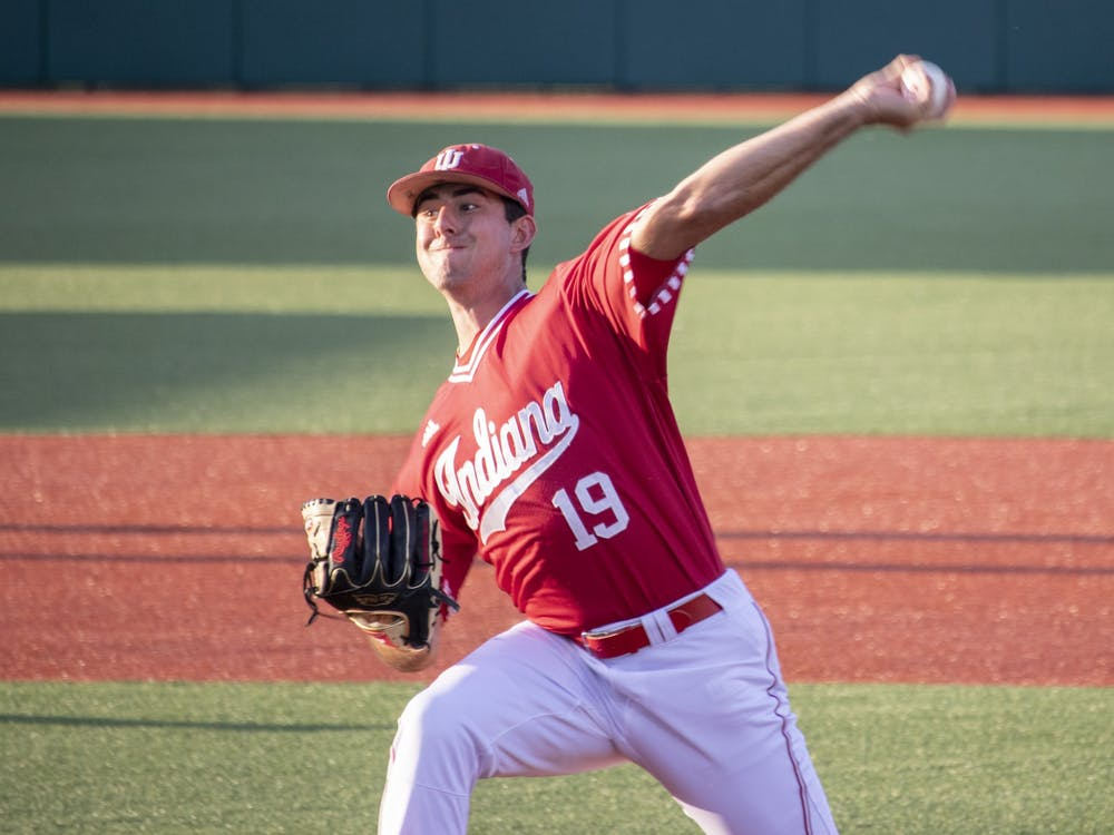 Then-sophomore pitcher Tommy Sommer pitches the ball against the University of Louisville on May 14, 2019, at Bart Kaufman Field.