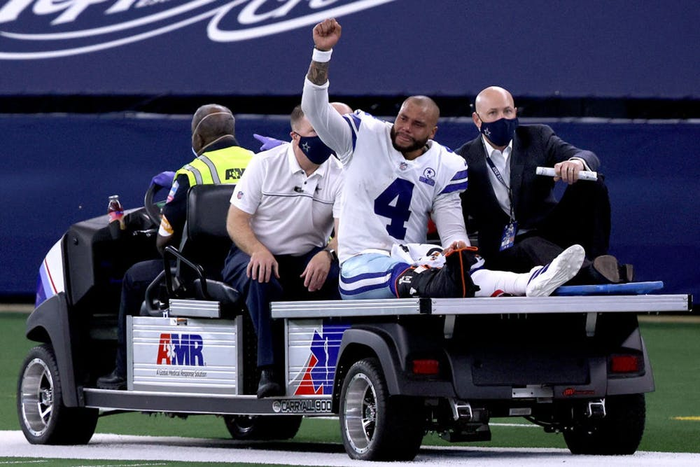 <p>Dak Prescott is carted off the field after sustaining a leg injury against the New York Giants Oct. 11, 2020, at AT&amp;T Stadium in Arlington, Texas.</p>