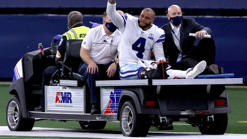 Dak Prescott is carted off the field after sustaining a leg injury against the New York Giants Oct. 11, 2020, at AT&T Stadium in Arlington, Texas.