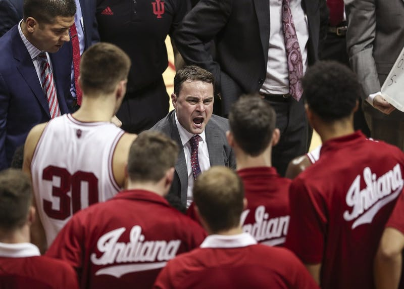 Head coach Archie Miller yells at the IU basketball team in a huddle during the Hoosiers' game against the Iowa Hawkeyes in Simon Skjodt Assembly Hall on Dec. 4. IU was recently named one of the final three schools in 5-star recruit D.J. Carton's recruitment.