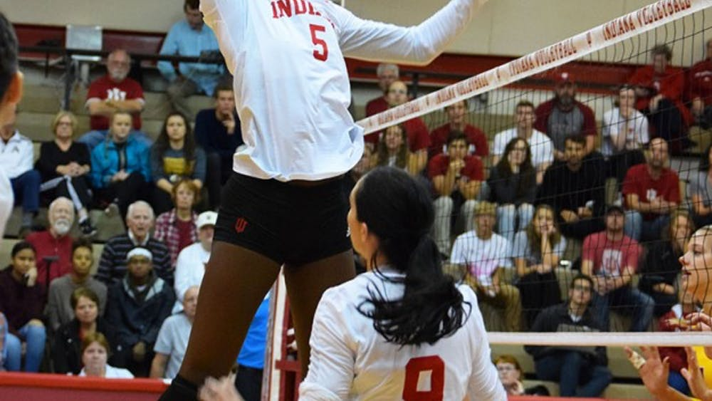 Middle Blocker Jazzmine McDonald fakes-out the opponents by pretending to go up for a kill during the game against Minnesota Friday evening.