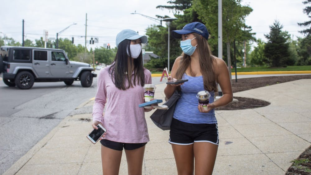 Freshmen Christie Lin and Maura Hodan walk down the sidewalk Aug. 18 by Eigenmann Hall. Masks are mandatory on IU's campus this year inside buildings and outside if social distancing cannot be maintained.