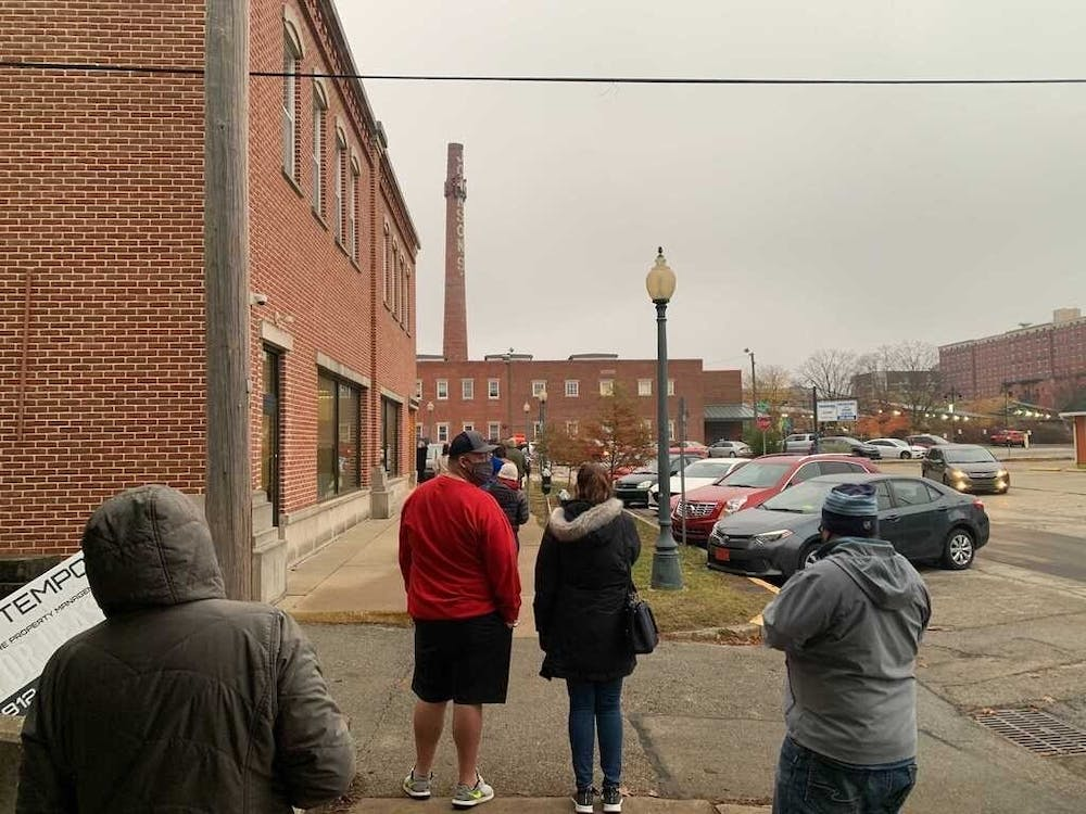 <p>Monroe County residents wait Oct. 26 outside to vote. </p>