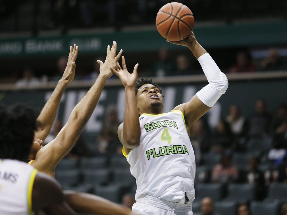 University of South Florida basketball player Michael Durr shoots the ball Jan. 21, 2020. Durr is transferring to IU for his senior season.