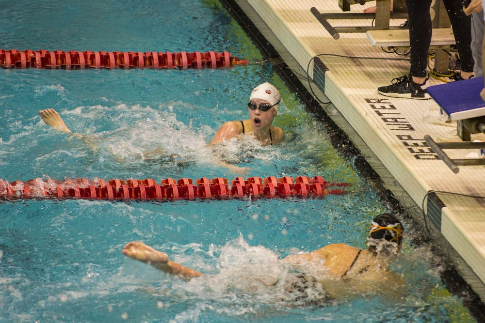 <p>IU swimmer Cassy Jernberg looks at the scoreboard after finishing the 1,000-yard freestyle race Jan. 25 in a meet against Purdue at the Counsilman-Billingsley Aquatics Center. Jernberg won the event with a time of 10:10.52.</p>