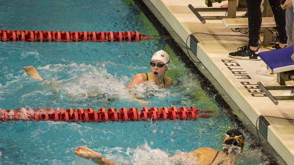 IU swimmer Cassy Jernberg looks at the scoreboard after finishing the 1,000-yard freestyle race Jan. 25 in a meet against Purdue at the Counsilman-Billingsley Aquatics Center. Jernberg won the event with a time of 10:10.52.