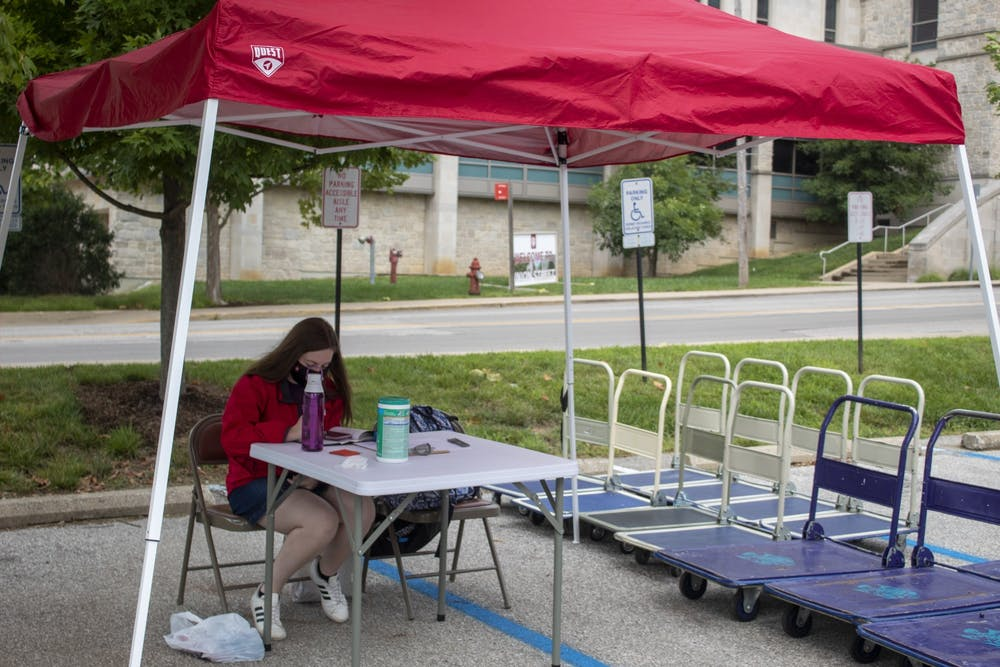<p>Residential assistant Jada Collins runs the cart sign-out station Aug. 18 outside of Eigenmann Hall. IU Student Association passed a bill paying residential assistants&#x27; and CommUNITY educators&#x27; hazard pay.</p>