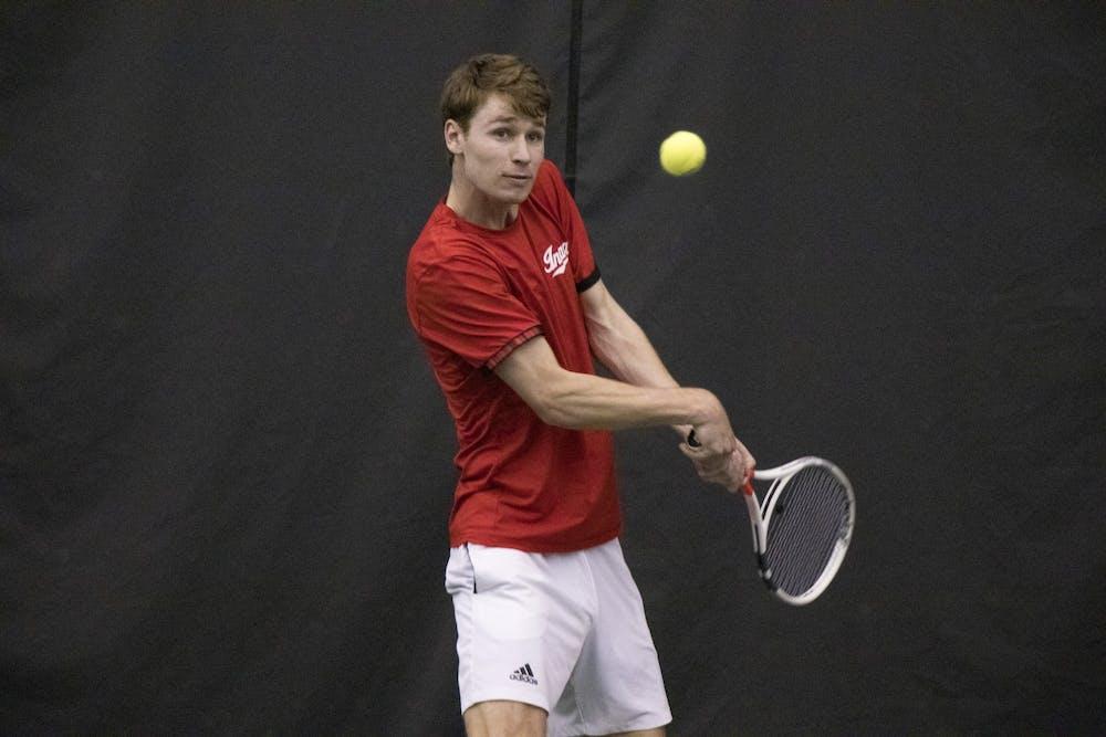 <p>IU senior Bennett Crane returns the ball in a match against Purdue University on Feb. 22 at Schwartz Tennis Center. IU defeated Purdue 4 to 1.</p>
