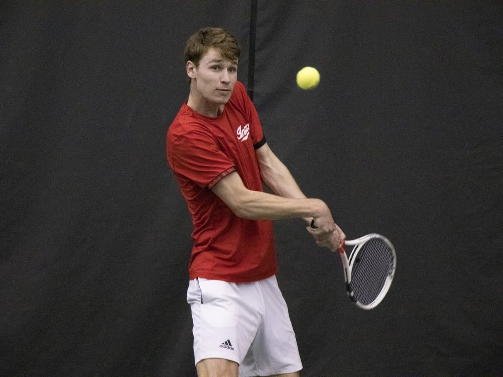 IU senior Bennett Crane returns the ball in a match against Purdue University on Feb. 22 at Schwartz Tennis Center. IU defeated Purdue 4 to 1.