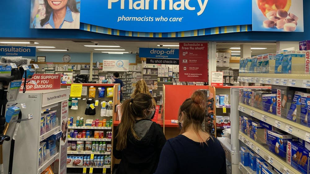 Bloomington residents wait in line Oct. 1 at the Third Street CVS Pharmacy. IU will require all students, staff and faculty whose work or class schedule requires them regularly to be on campus to get a flu vaccine and report it to the university.