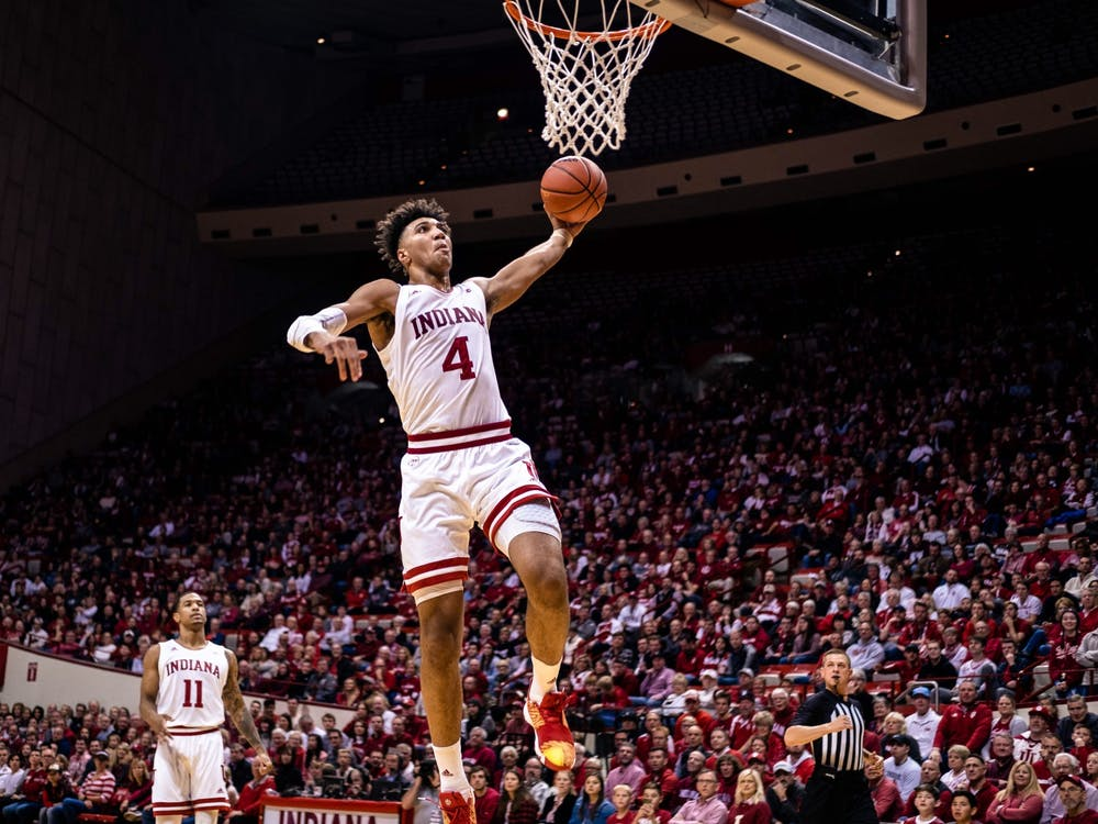 Then-freshman Trayce Jackson-Davis dunks the ball in the second half Nov. 16, 2019, at Simon Skjodt Assembly Hall. Jackson-Davis announced Friday on Twitter he was staying at IU for his junior season.