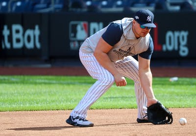 New York Yankees first baseman Luke Voit catches a ground ball Oct. 10.