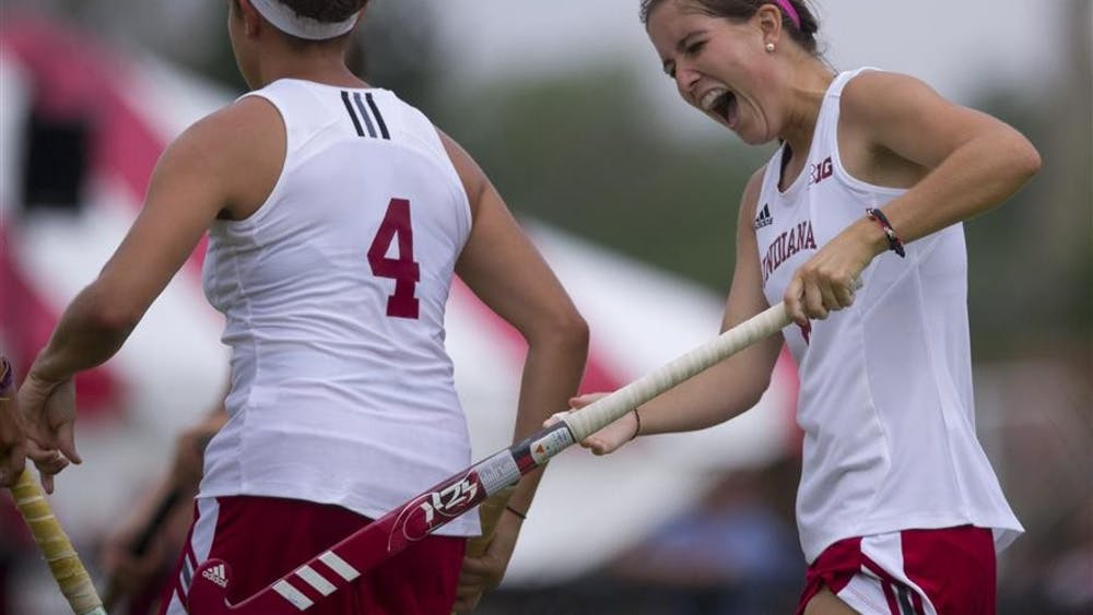 Senior Emily Bowker celebrates with teamate Morgan Dye after IU scores during IU's match against Radford on Sept. 8 at the IU Field Hockey Complex