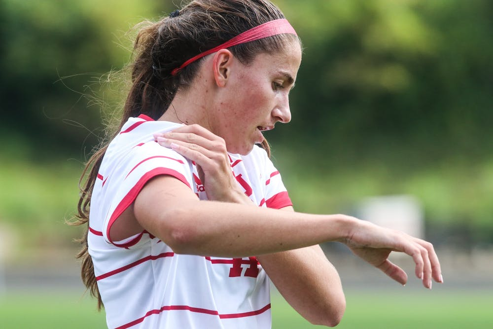 <p>Sophomore forward Anna Bennett fixes her sleeve Oct. 3, 2021, in Bill Armstrong Stadium. Indiana and Michigan drew 0-0 after the game was called due to bad weather.</p>