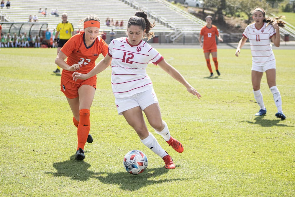 <p>Graduate forward Melanie Forbes dribbles against Illinois Sept. 26, 2021, at Bill Armstrong Stadium. Indiana defeated Illinois 2-1. </p>