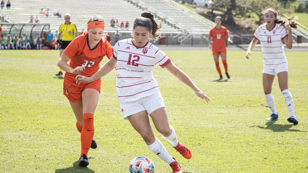 Graduate forward Melanie Forbes dribbles against Illinois Sept. 26, 2021, at Bill Armstrong Stadium. Indiana defeated Illinois 2-1.