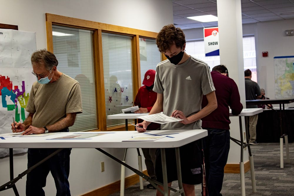 <p>Voters  fill out their ballots during the first day of early voting on Oct. 6 at Monroe County&#x27;s only early voting location.The early voting hours have been expanded due to a large volume of early voters.</p>