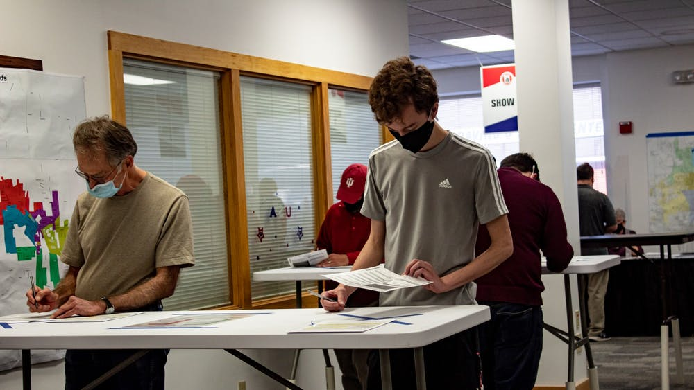 Voters  fill out their ballots during the first day of early voting on Oct. 6 at Monroe County's only early voting location.The early voting hours have been expanded due to a large volume of early voters.