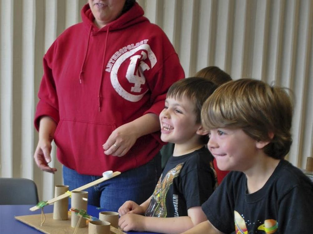 From left to right: Charity Taboas, Alex Taboas and Isaiah Bankston play with their catapult on Saturday at the Wonderlab Museum. Wonderlab put on an exhibition showcasing catapult to kids where children build their own catapult.