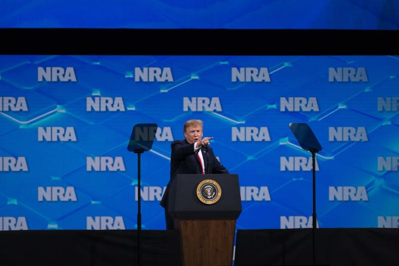 President Trump points at the media and calls them fake news during the NRA-ILA Leadership Forum on April 26 in Indianapolis. Trump spoke about the history of gun violence in America, and he introduced people who have experience dealing with intruders and shooters.