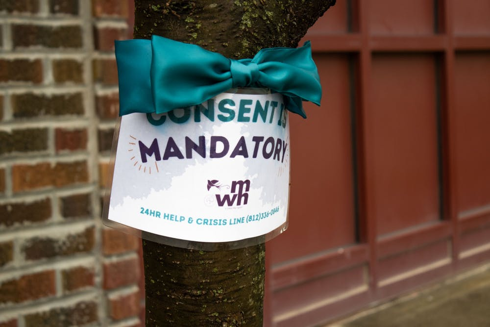 <p>A Middle Way House sign reading &quot;Consent is mandatory&quot; hangs on a tree Sunday. Middle Way House&#x27;s Annual Spring Luncheon will be from 11:30 a.m.-1:30 p.m. Thursday at Switchyard Park.</p>