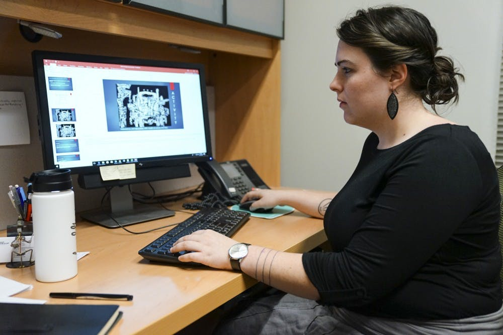 Lauren King, arts-based wellness experiences manager at Eskenazi Arts Museum, works on developing a stress management presentation Nov. 13 in her temporary office at the Smith Research Building. King is going to lead the new arts-based therapy program for the museum, scheduled to open in the fall of 2019.
