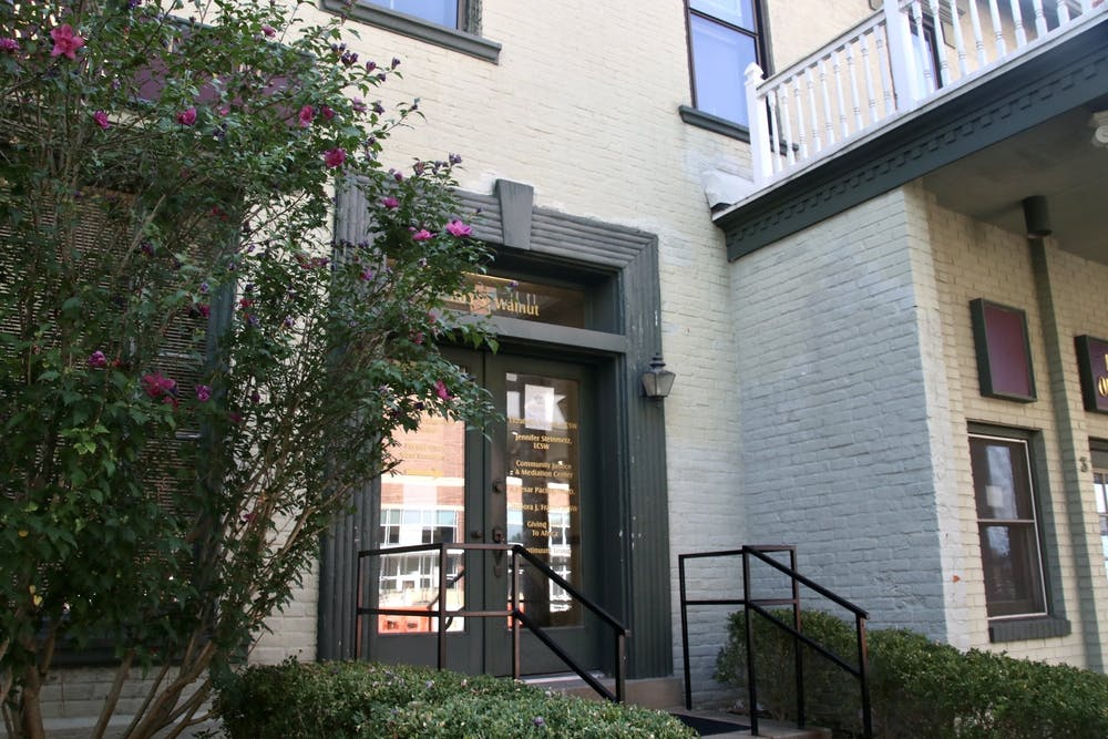 <p>205 S. Walnut St. is pictured Aug. 20. The Community Justice and Meditation Center is located on the upper level. </p>