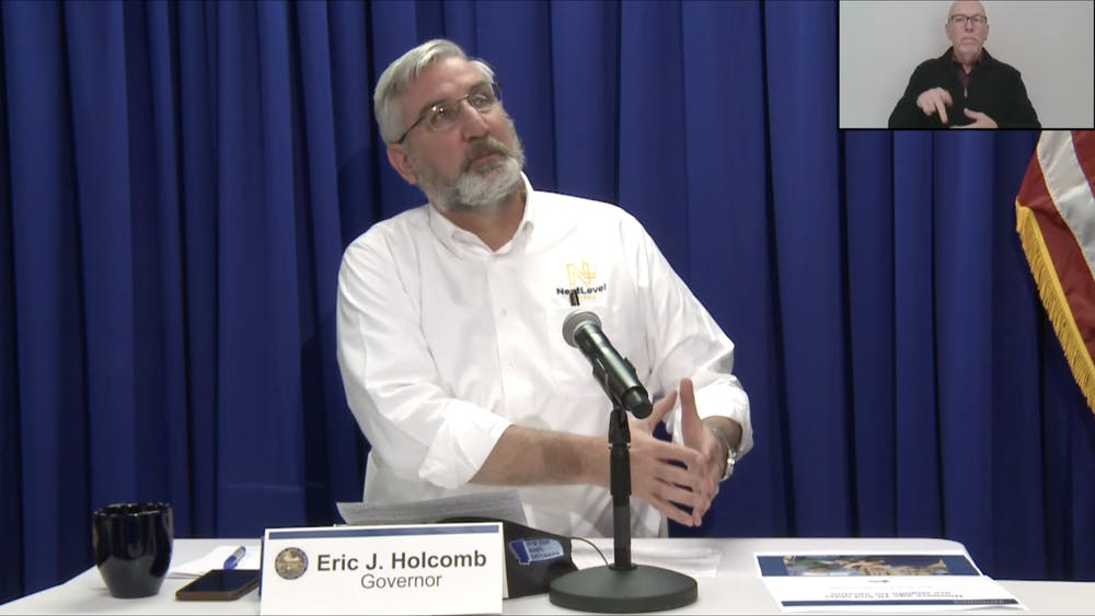Gov. Eric Holcomb speaks Wednesday during a weekly virtual press conference giving updates about the COVID-19 pandemic. Holcomb said the state predicts 455,000 residents will receive the vaccine by the end of January.