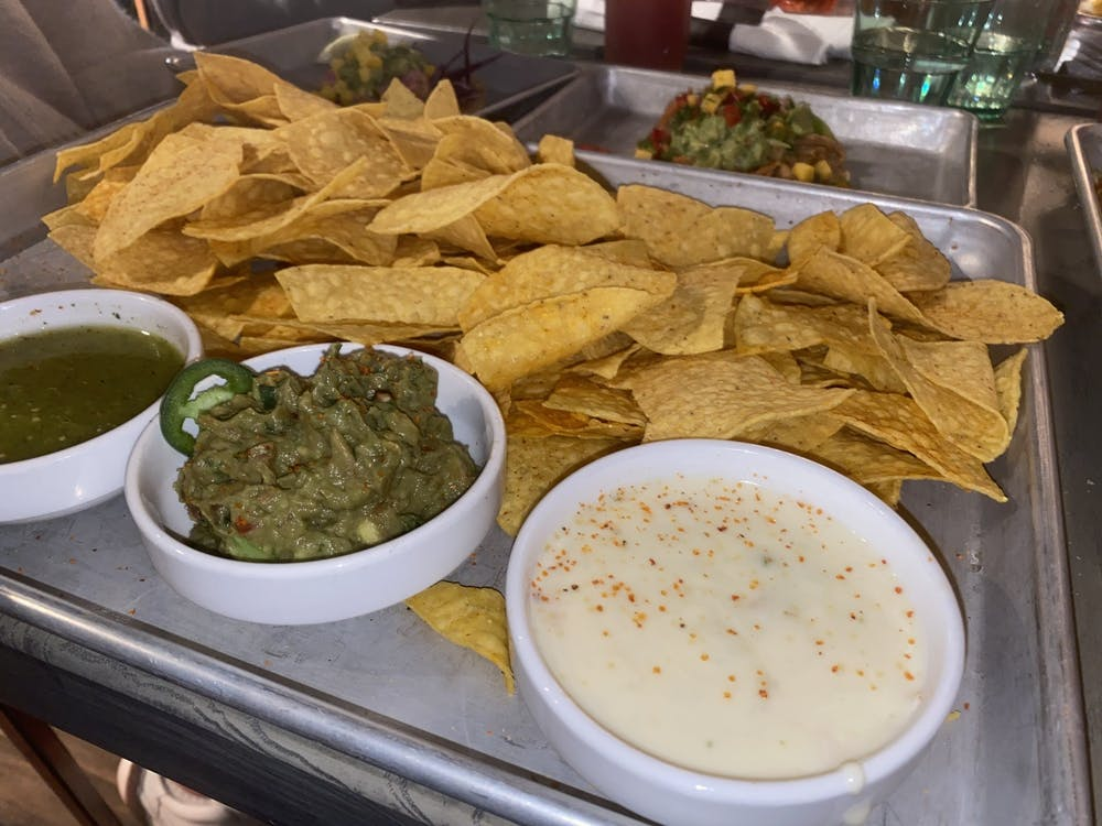 <p>A chips and salsa flight from Social Cantina appears Wednesday. The flight includes a choice between two salsas and either white-cheese queso, guacamole or Cali-guacomole, which is topped with pico de gallo. </p>