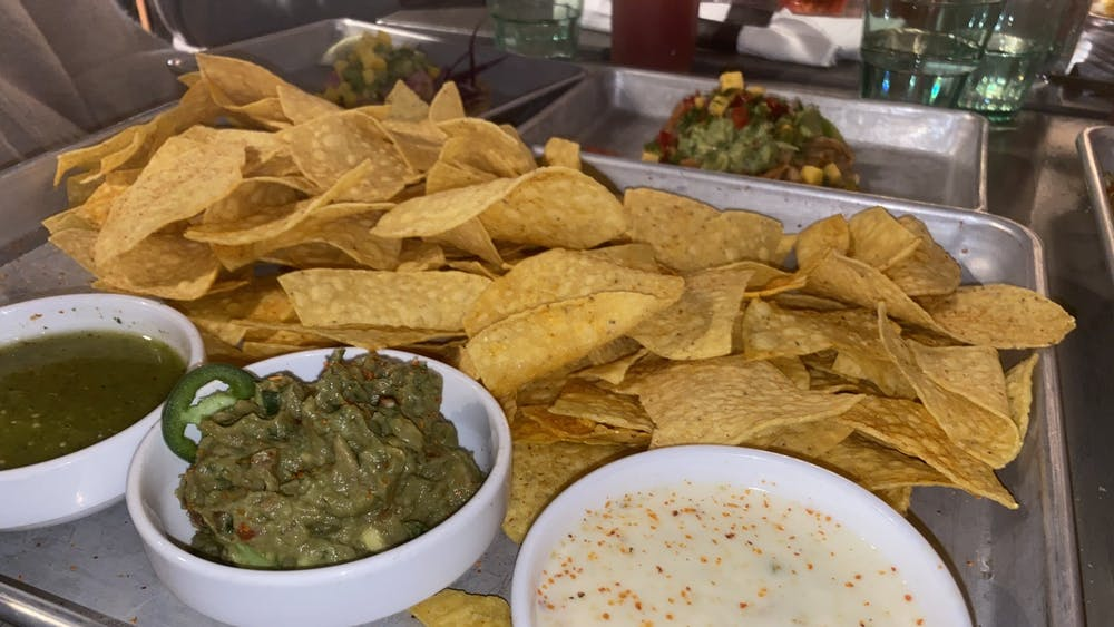 A chips and salsa flight from Social Cantina appears Wednesday. The flight includes a choice between two salsas and either white-cheese queso, guacamole or Cali-guacomole, which is topped with pico de gallo.