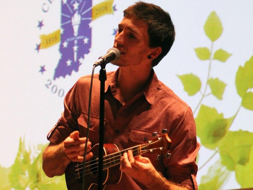 Jake Ryan plays an original song on the ukulele at the Green Light Celebration in Whittenberger Auditorium.