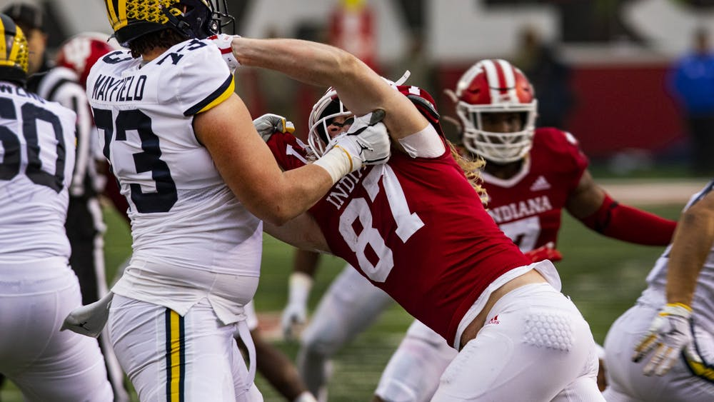 Then-junior defensive lineman Michael Ziemba attempts to tackle Michigan sophomore offensive lineman Jalen Mayfield on Nov. 23, 2019, in Memorial Stadium. No. 13 IU plays No. 23 Michigan at noon on Saturday to try and stay undefeated this season.