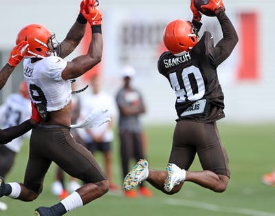 Cleveland Browns defensive back Tigie Sankoh intercepts a pass intended for wide receiver Dorian Baker on Aug. 2 at training camp. The Browns could be fighting for a playoff spot later this NFL season.