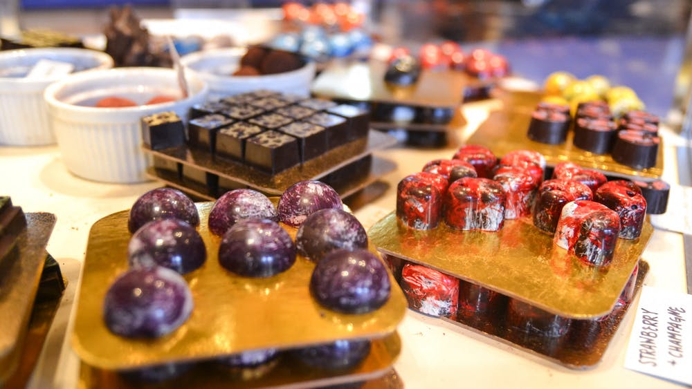 """A selection of chocolates sit on a counter. In February, the Bloomington community will celebrate """"The Month of Chocolate"""" with various chocolate-themed events."""