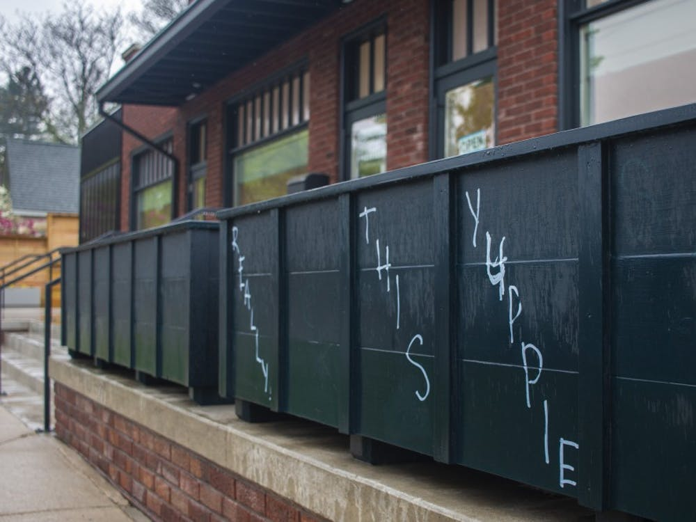 """A vandal graffitied """"Really fuck this yuppie shit"""" onto planters between April 16 and April 17 outside the FAR Center for Contemporary Arts. The profane words have been painted over."""