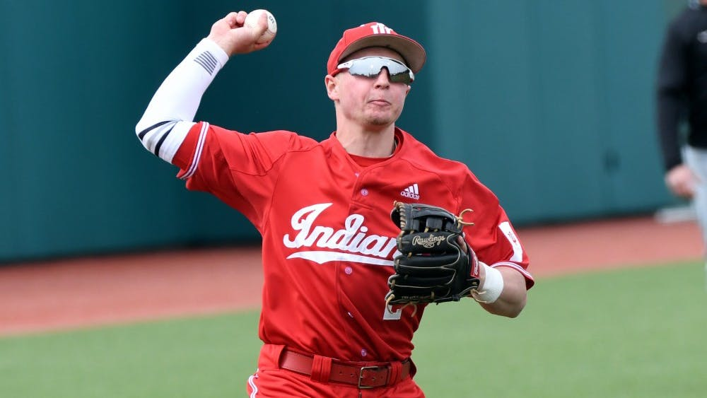 Freshman Cole Barr looks to throw to first base against Purdue on April 8 at Bart Kaufman Field. Barr is playing Amsterdam Mohawks this summer.