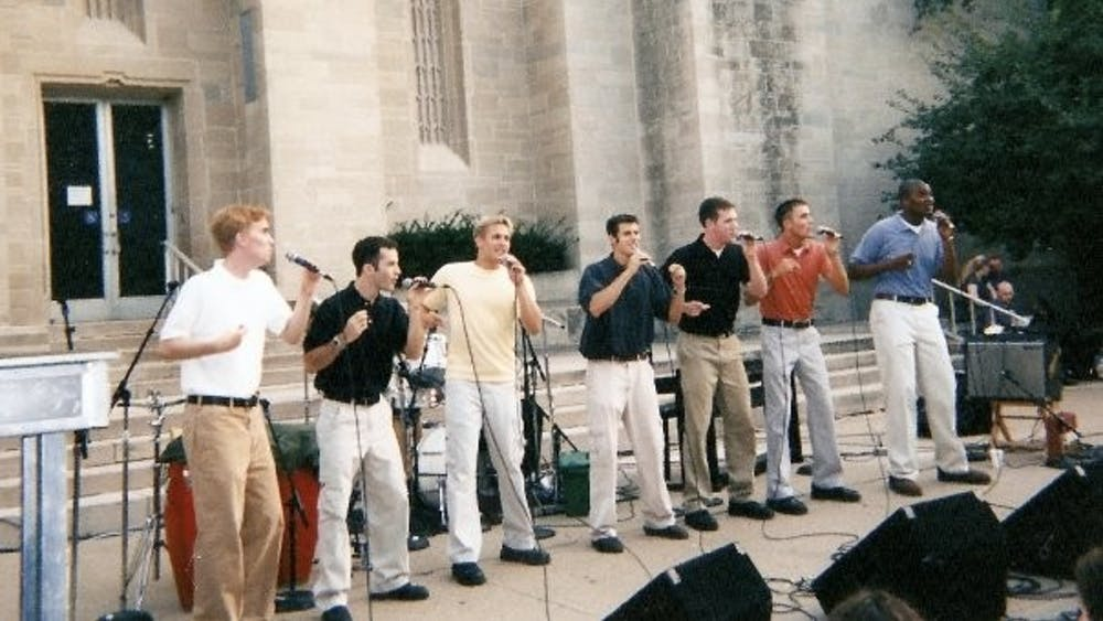 Straight No Chaser sings in front of the IU Auditorium during Culture Fest in 2000. Ryan Ahlwardt, a former member of the group, was commissioned to write a song celebrating IU's bicentennial.