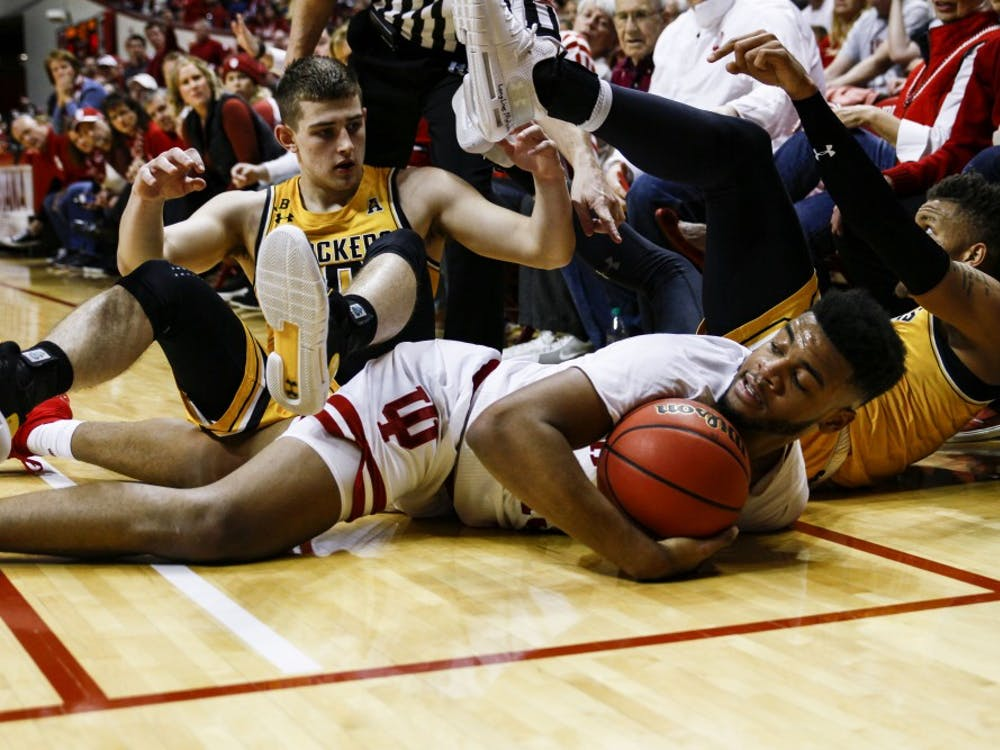 Senior forward Juwan Morgan dives for a lost ball against Wichita State University on March 26 at Simon Skjodt Assembly Hall. IU lost to Wichita State, 73-63.